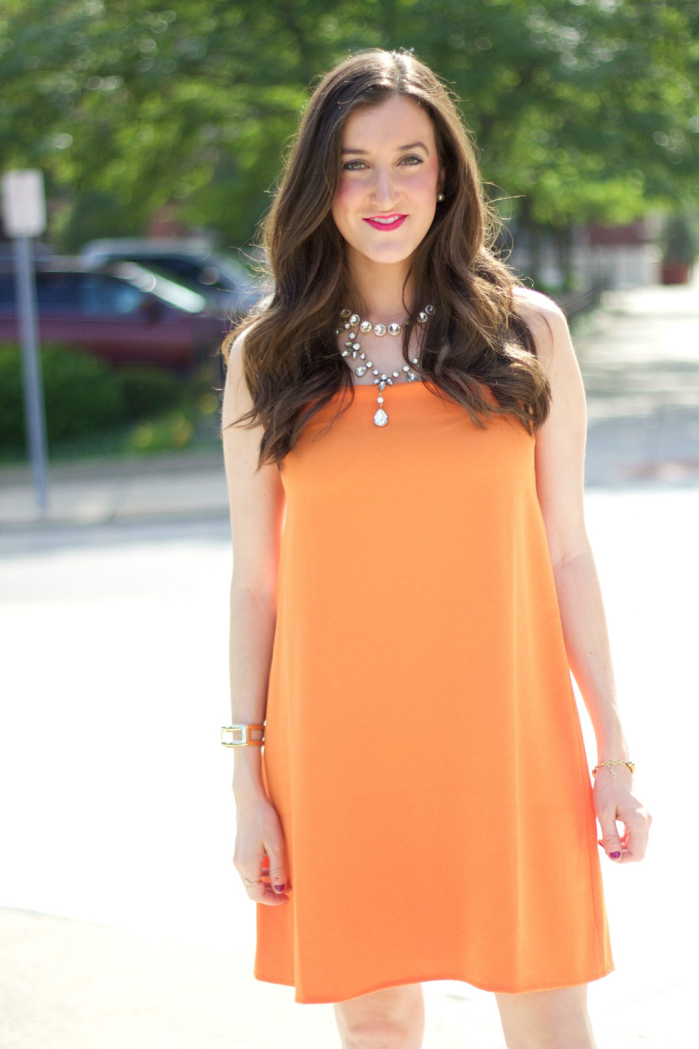 Orange Dress with Layered Necklaces