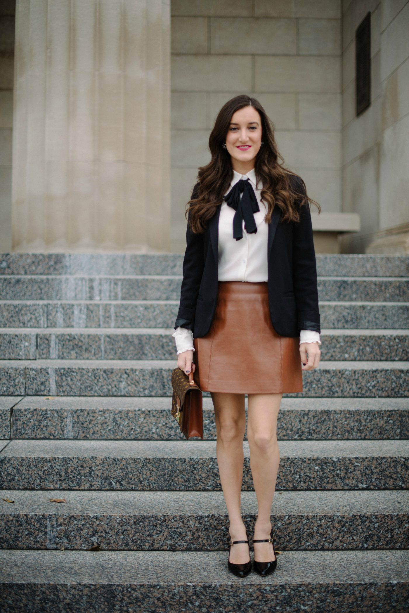 bow blouse with brown leather skirt