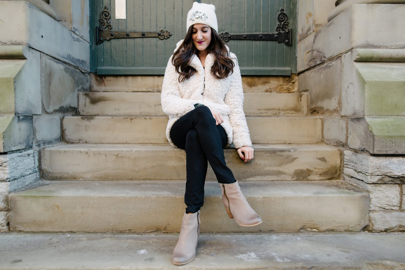 sheepskin coat with embellished beanie