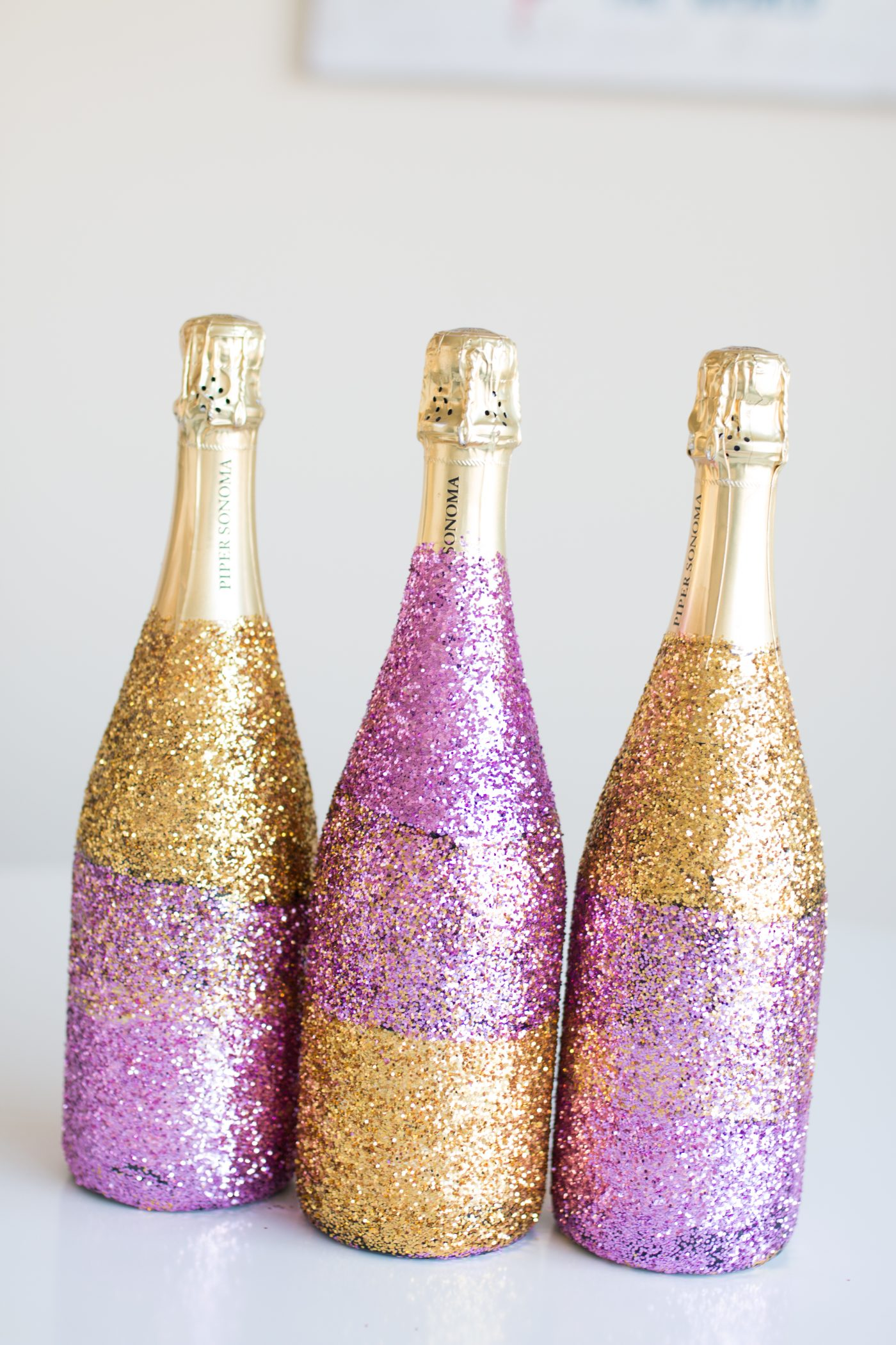 Diy glitter ombr champagne bottle baubles to bubbles for How to glitter wine bottles
