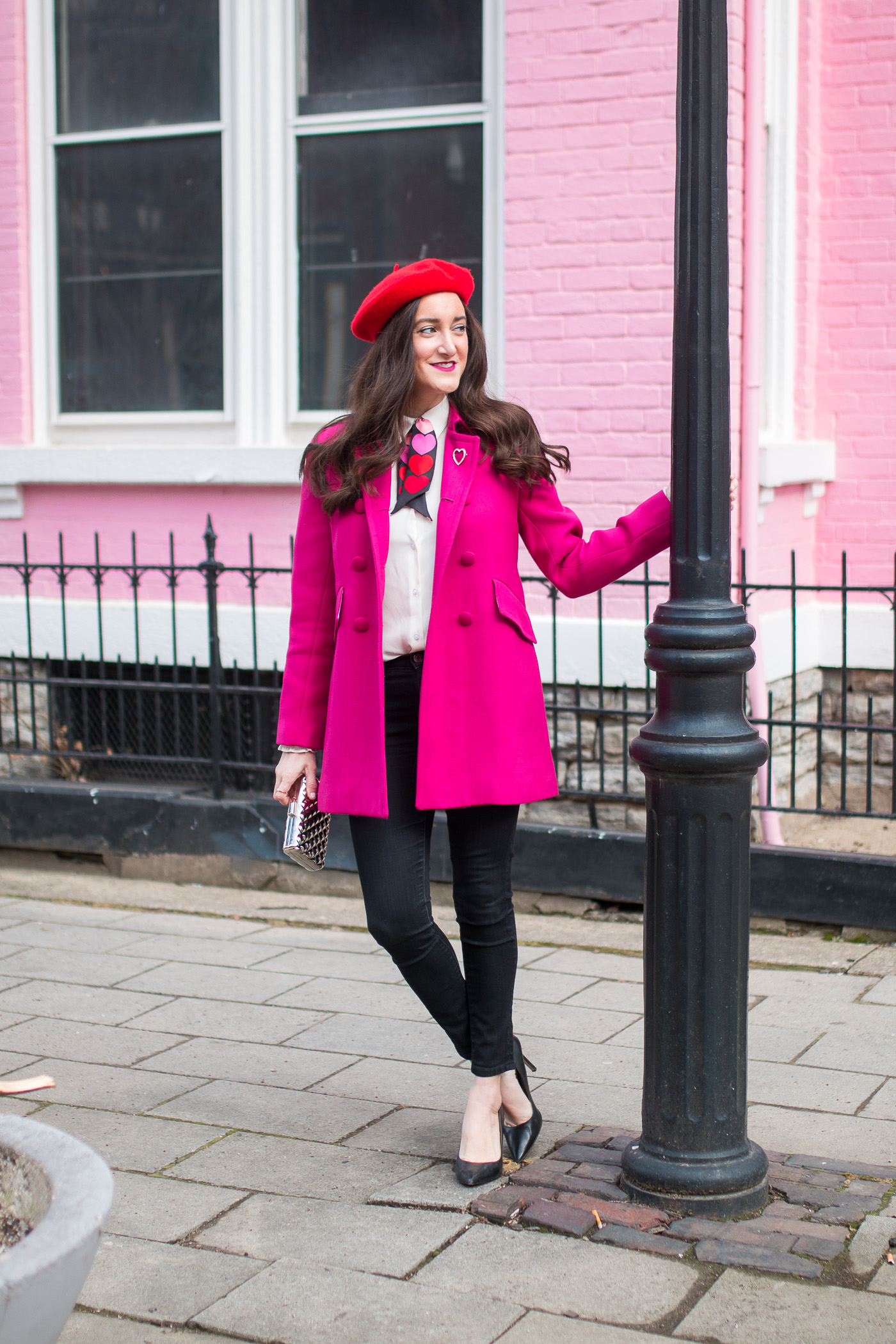 Red beret with pink coat