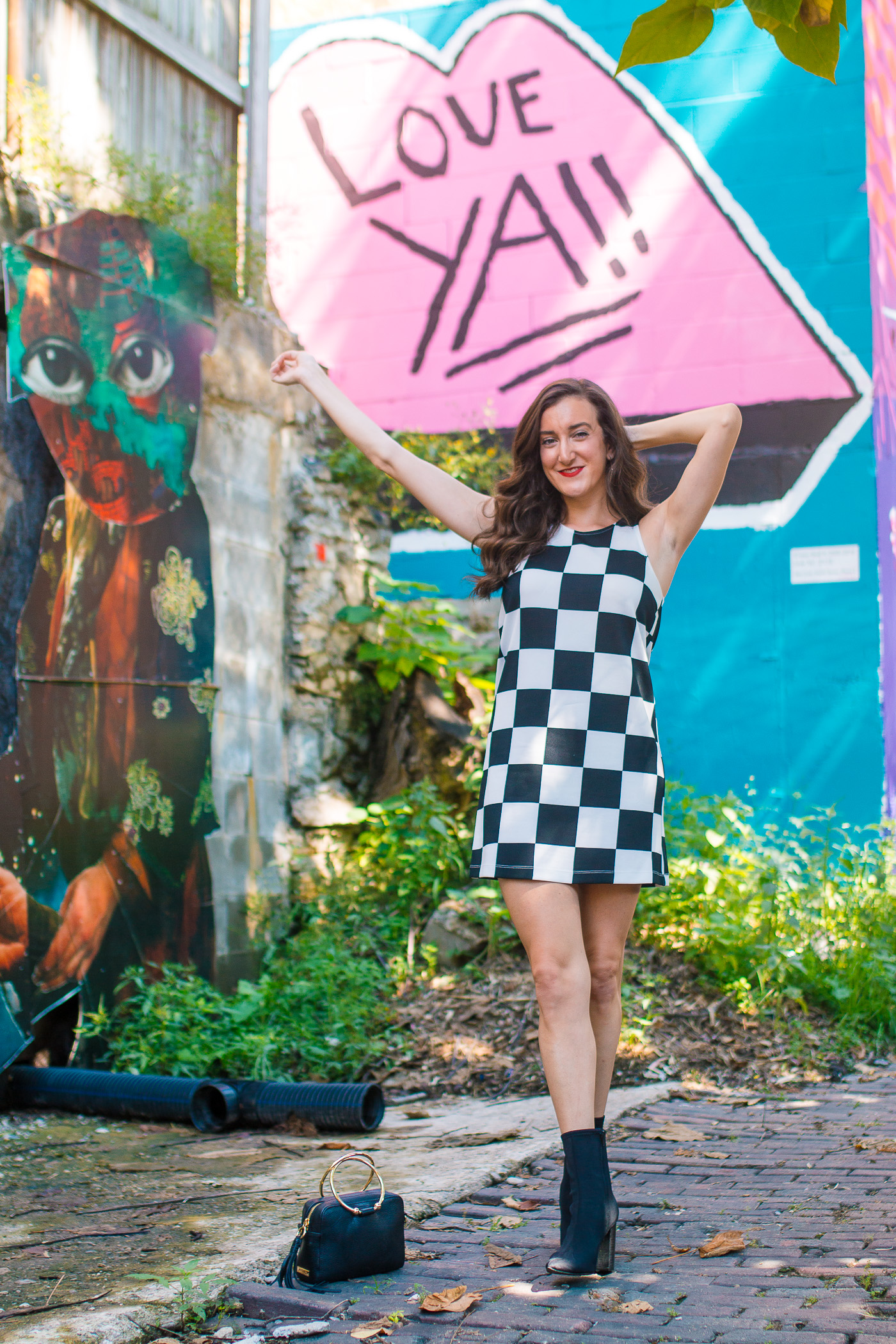Cincinnati Fashion Blogger Olivia Johnson wearing checkered dress