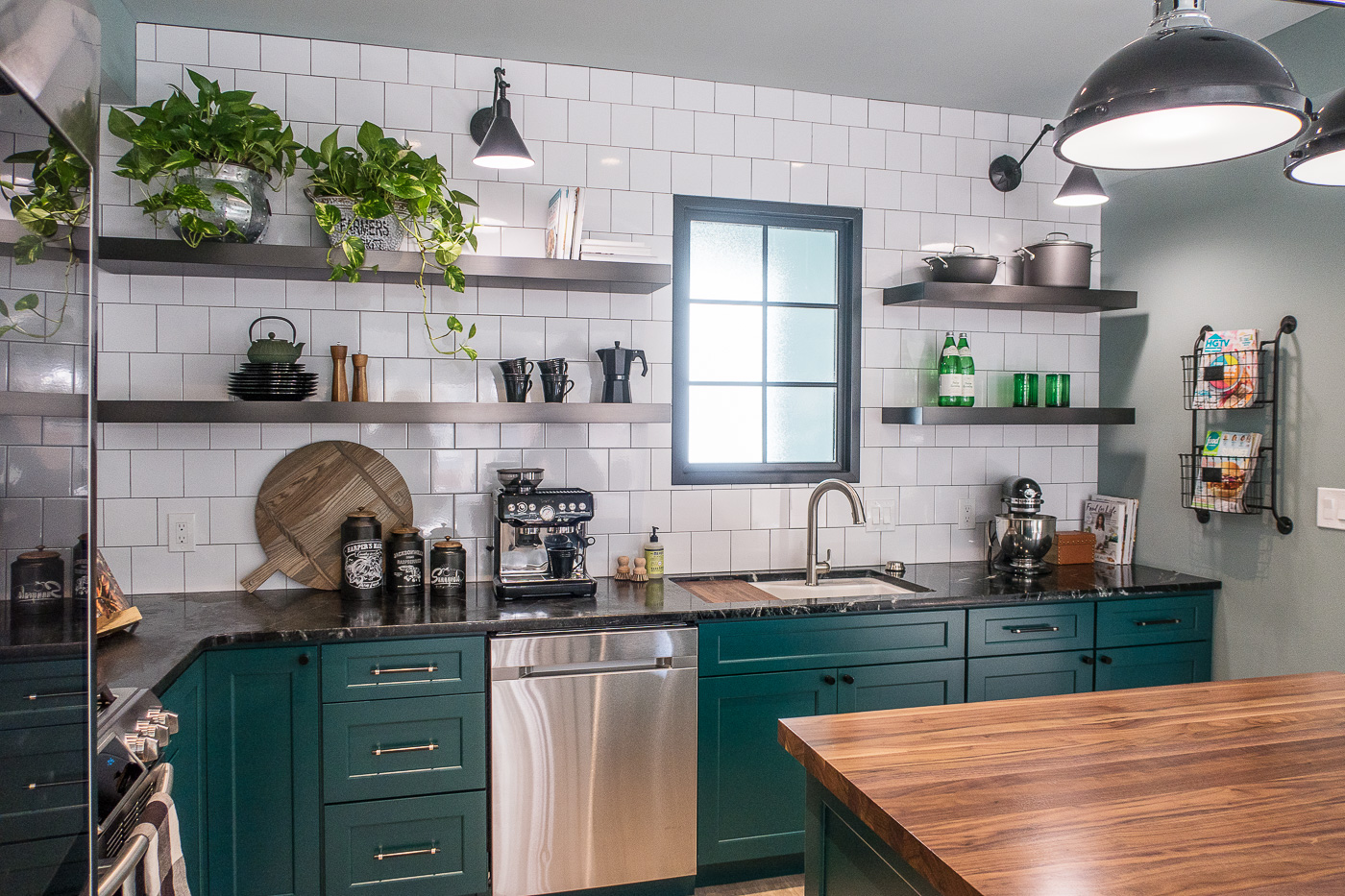 Kitchen with Green Cabients and Subway Tile