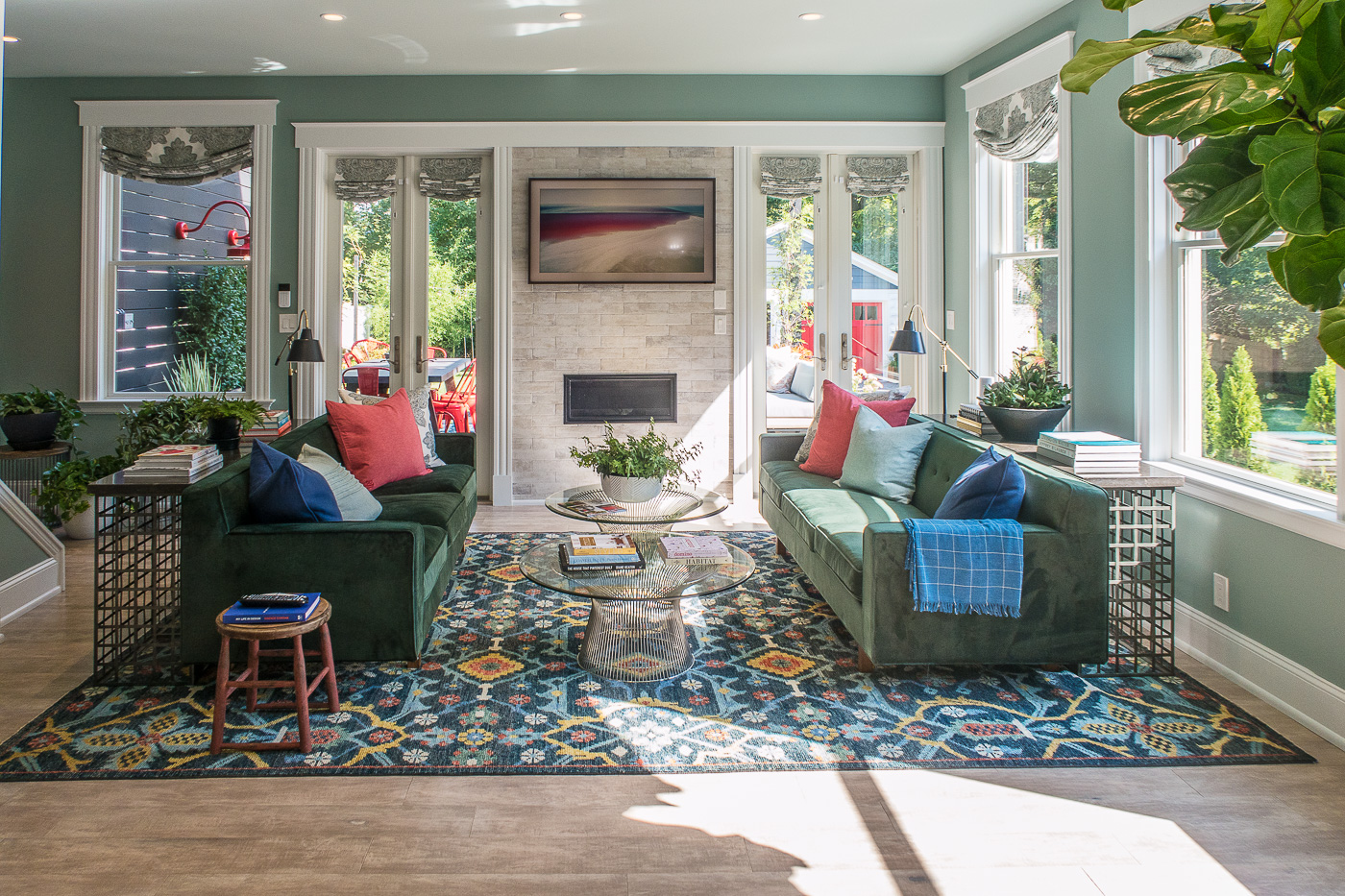 Living Room with Green Couches