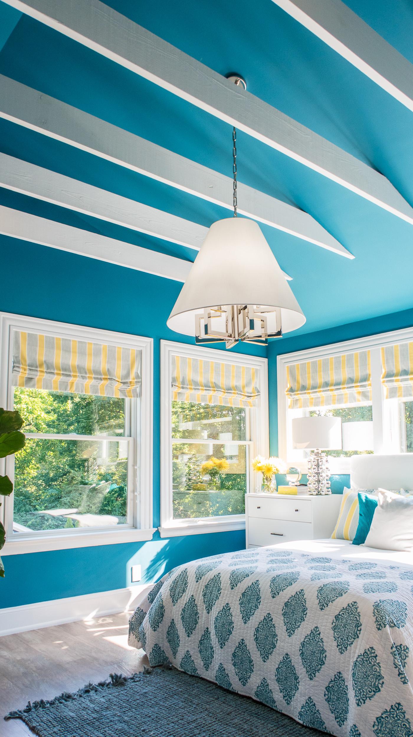 Blue Bedroom with Wood Beams