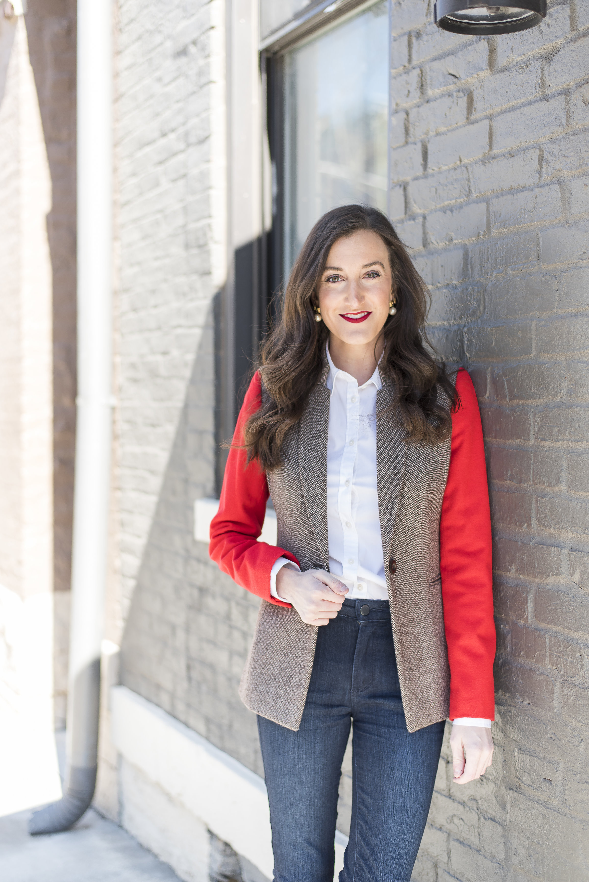 a red jacket with brown hair