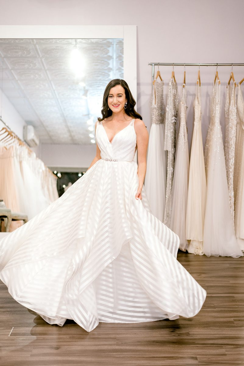 Fashion blogger Olivia Johnson of Baubles to Bubbles wearing a striped Hayley Paige wedding dress