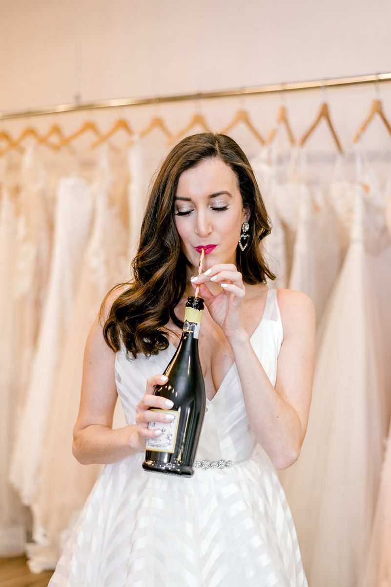 Fashion blogger Baubles to Bubbles sipping Cupcake Champagne at Luxe Redux Bridal in Cincinnati
