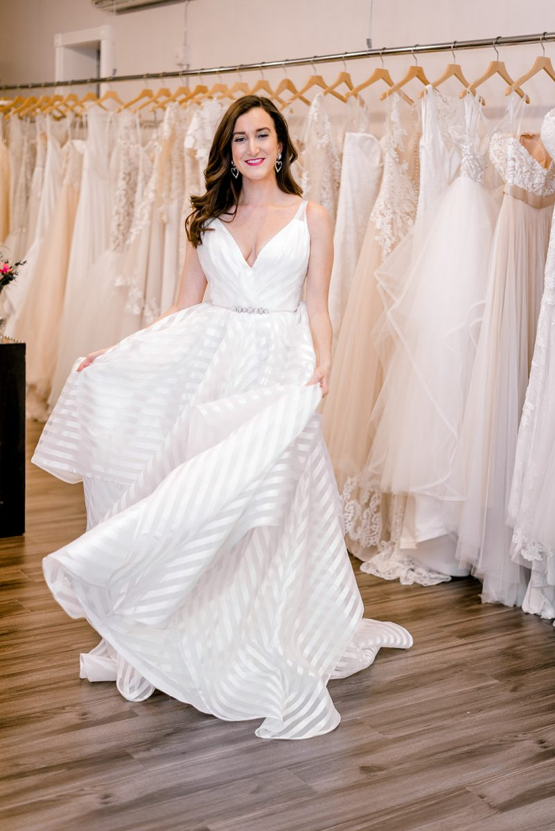 Fashion blogger Olivia Johnson of Baubles to Bubbles wearing a Hayley Paige wedding dress