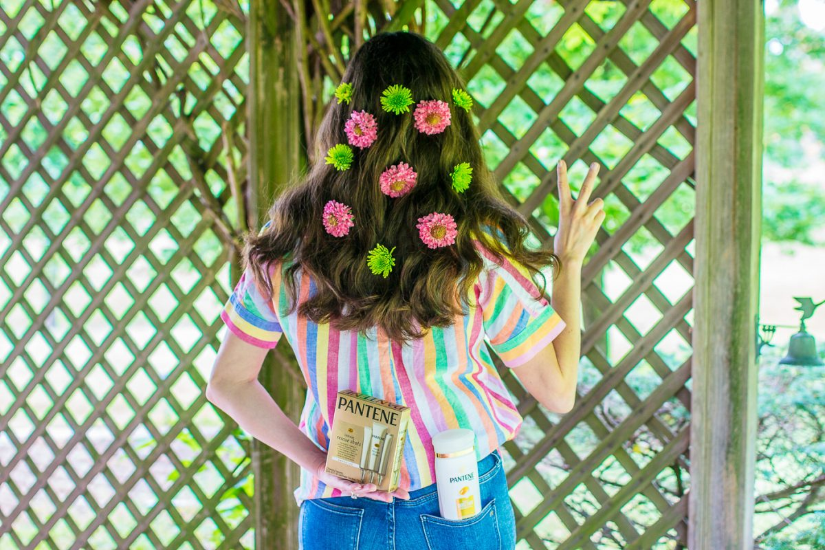 Blogger Olivia Johnson of Baubles to Bubbles wear flowers in her hair for music festival ideas