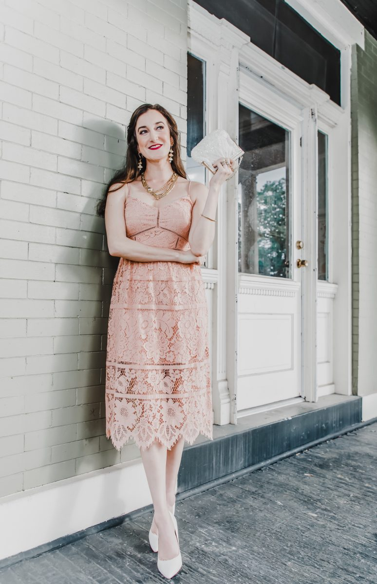 Cincinnati fashion blogger Baubles to Bubbles wears a lace dress for a bridal shower photoshoot