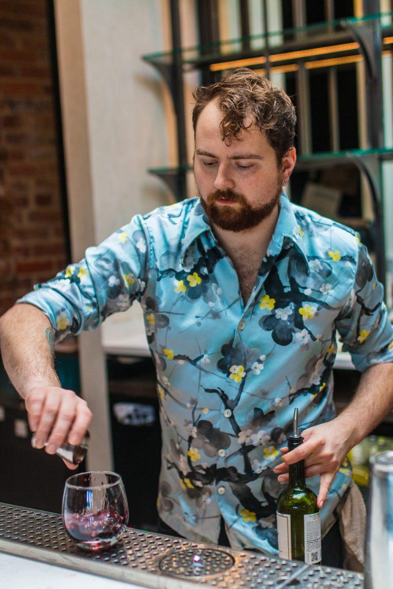 The bartender at Comfort Station makes craft cocktails