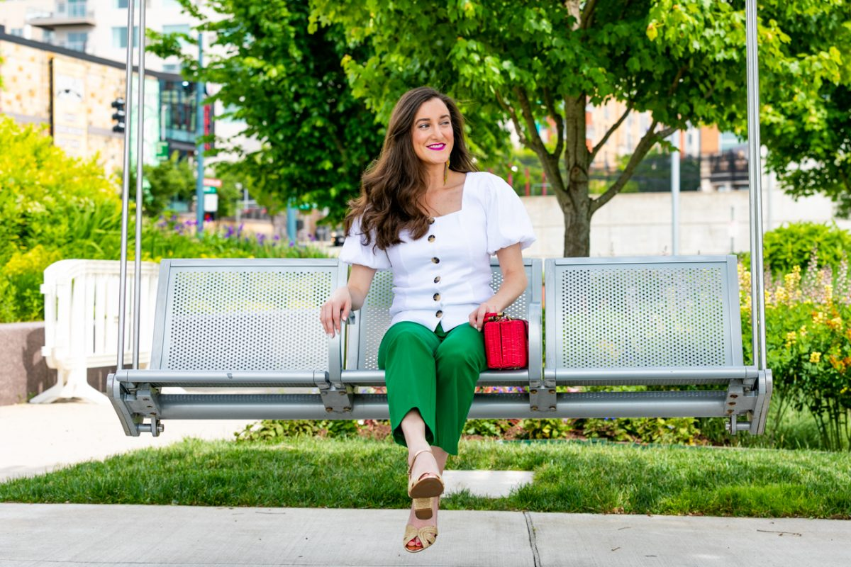 Green pants with a white top as seen on fashion blogger Baubles to Bubbles