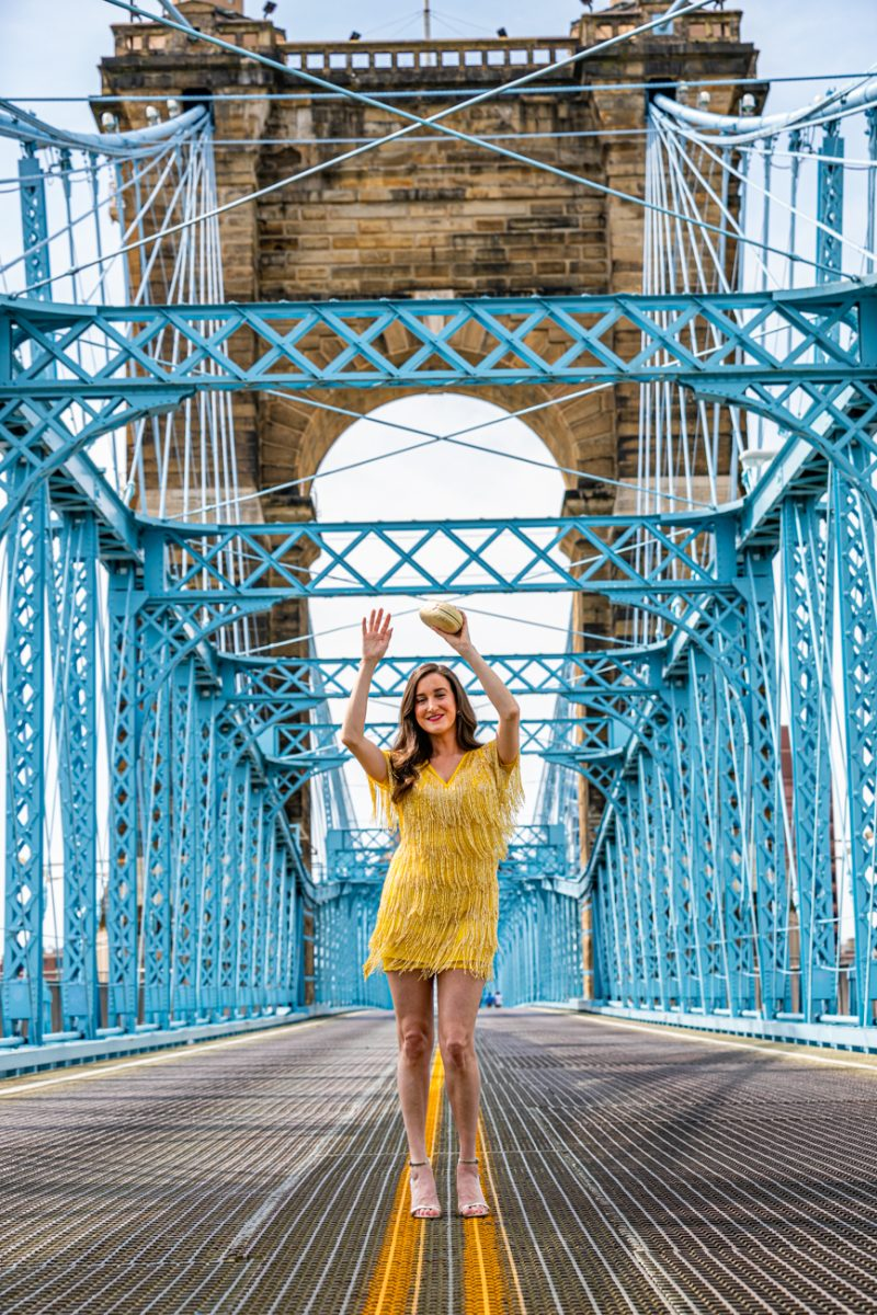 Cincinnati blogger in an outfit on the Roebling Bridge
