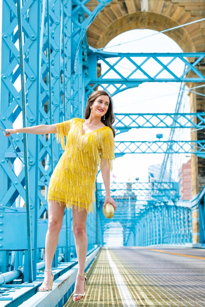 Fashion blogger Baubles to Bubbles on the Roebling Bridge wearing an ASOS yellow beaded fringe dress