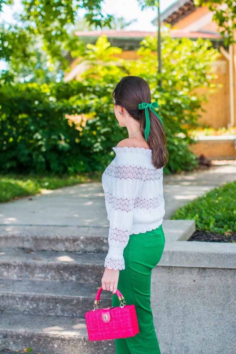 girl wears a green velvet bow
