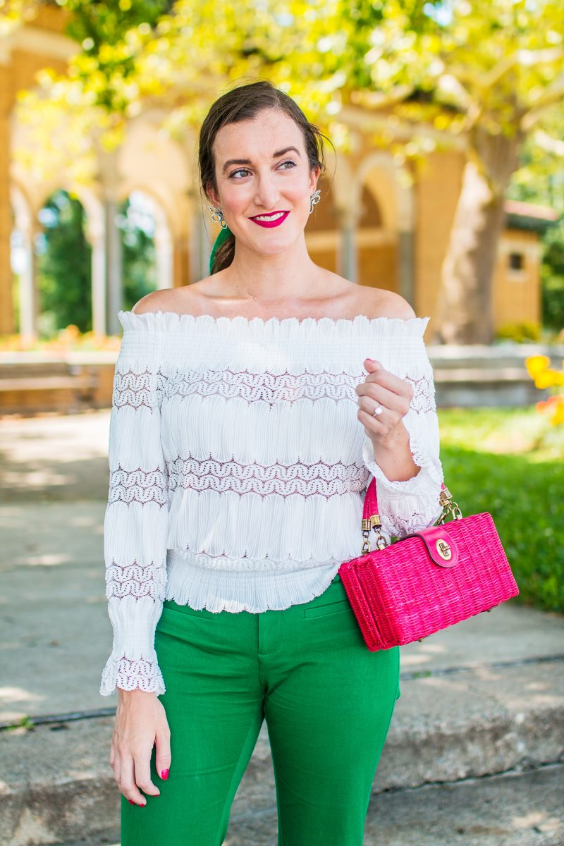 girl wears a white off the shoulder top and a green bow