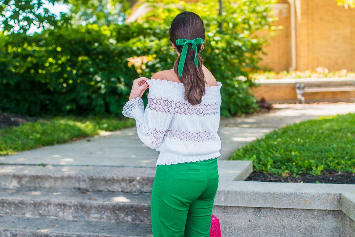 Green velvet bow worn by a girl