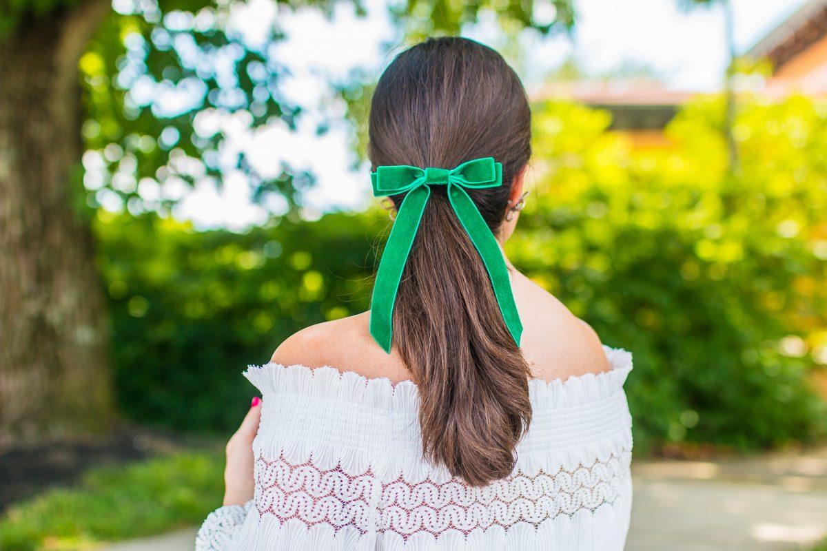 Bardot Bow Gallery Green Velvet Bow worn by a girl