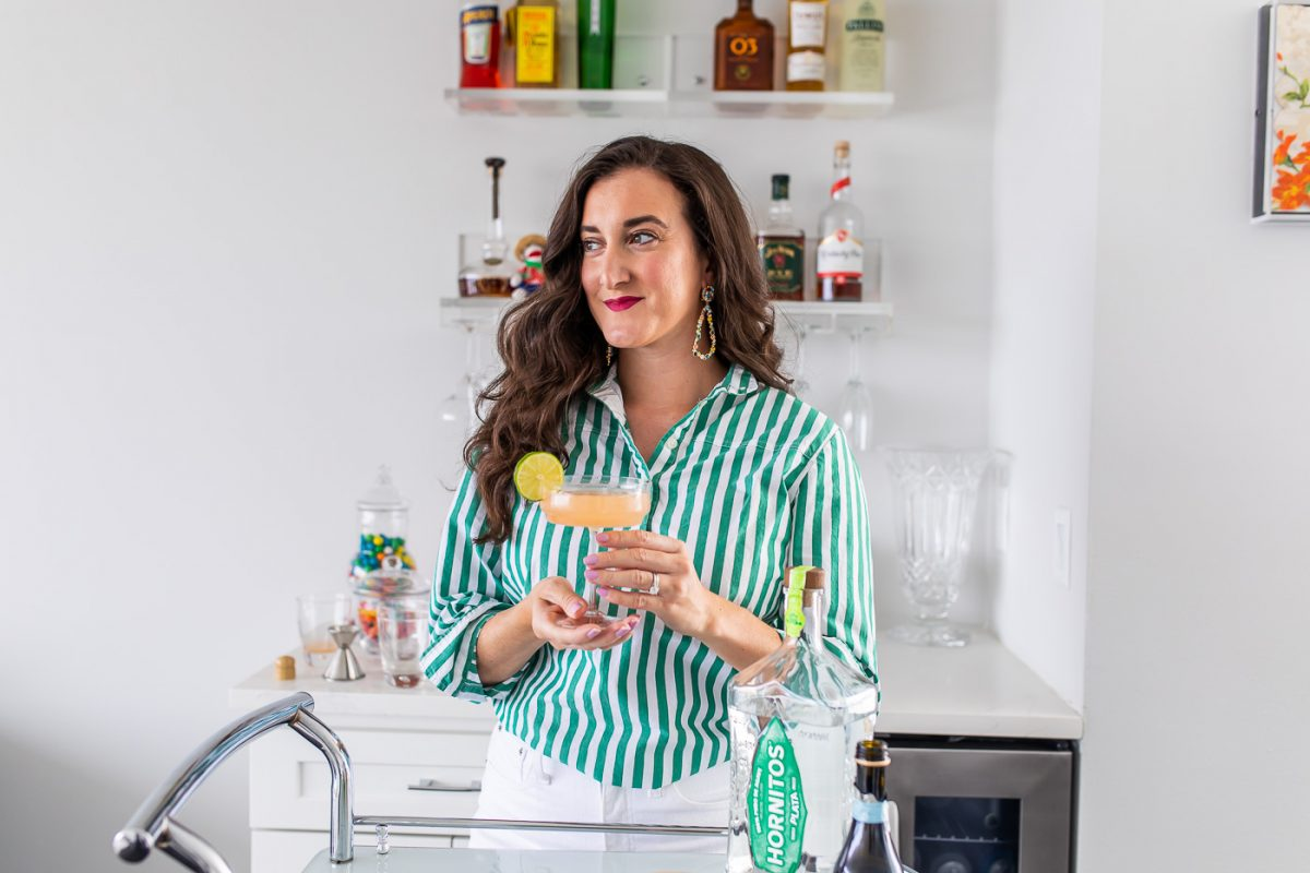 Olivia Johnson with prosecco Palomca cocktail
