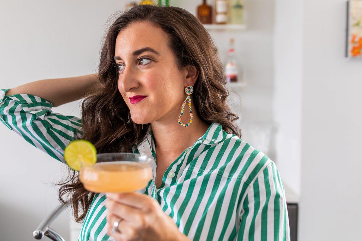 Blogger Olivia Johnson wearing Lulu Frost Earrings