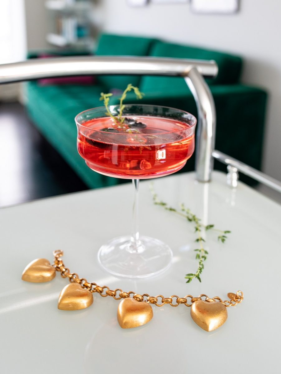 Sparkling Blueberry Thyme Cocktail with Heart Charm Bracelet